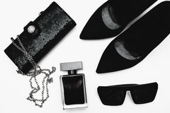 Shoes with perfume and accessories. Stylish female accessories. Black  Shoes with perfume and accessories Stock Photos