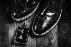 Shoes with perfume ans cuff. Mans shoes with perfume ans cuff Stock Photo