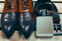 Shoes, perfume and belt Royalty Free Stock Image