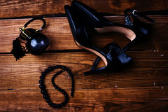 Shoes and perfume. Black female shoes and perfume Royalty Free Stock Images