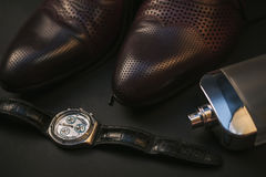 Shoes with perfume and watch. Brown leather men`s accessories. Shoes with perfume and watch Stock Photography