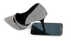 Shoes and the phone Royalty Free Stock Photo
