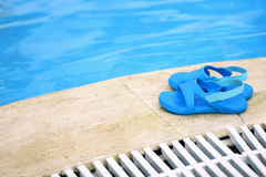 Shoes and pool Royalty Free Stock Photos