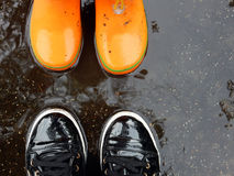 Shoes in a puddle Stock Images