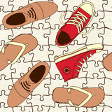 Shoes on puzzle floor Royalty Free Stock Image