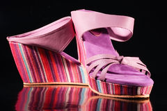 Shoes in rainbow colors on isolated background. Women leather shoes. purple color. fancy shoe sole in all rainbow colors. isolated on black background Royalty Free Stock Image