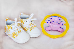 Shoes and rattle Royalty Free Stock Image