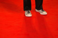 Shoes on red carpet. Black and white shoes on red carpet Royalty Free Stock Images