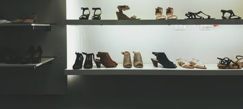 Shoes  retail display. Rows of women& x27;s dress shoes for sale Royalty Free Stock Photos