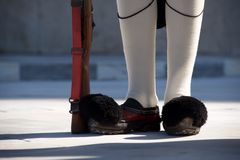 Shoes and rifle of Greek presidential guardsman Royalty Free Stock Photography