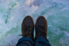 Shoes with a river as background Royalty Free Stock Image