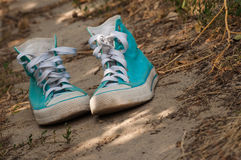 Shoes on the road Stock Image