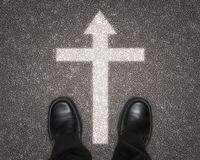 Shoes on Road with Religious Cross Royalty Free Stock Photography