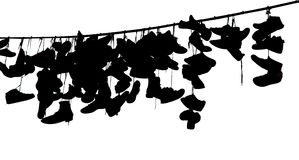 Shoes on rope Stock Images