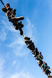 Shoes hanging on the rope Stock Photography