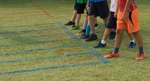 Shoes of runners on start point for run grass track. Ready for run Royalty Free Stock Photos