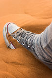 Shoes in the Sahara. Shoes sink into the sand of the Sahara stock images