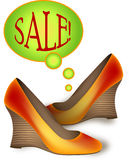 Shoes on sale. Orange new shoes are on sale Royalty Free Stock Photography