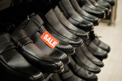 Shoes on sale. Black male shoes on sale Royalty Free Stock Image