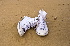 Shoes on the sand Stock Image