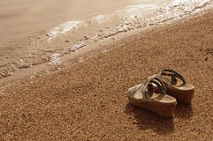 Shoes on the sand. Beach, sea wave Royalty Free Stock Photo