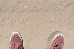 Shoes in the sand royalty free stock photos