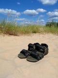 Shoes sand sky. Shoes on the sand beach sky Royalty Free Stock Photos