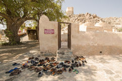 Shoes and sandals at Al Bidyah Mosque Fujairah UAE. Prayer time with shoes and sandals left outside Stock Image