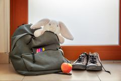Shoes and School bag with cuddly toy supplies and lunch Stock Image