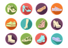Shoes set of vector flat icons. Multicolored Icons sandals, boots, low shoe, ballet slippers, high boot, gumshoes, knee Royalty Free Stock Images