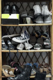 Shoes on the shoe rack.  stock photos