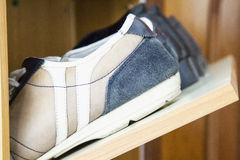Shoes on shoe rack. Close up, horizontal image stock photography