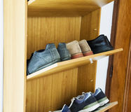 Shoes in a shoe rack. Multilevel, horizontal image stock images