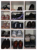 Shoes in shoe storage rack. Men and womans shoes in shoe storage rack Stock Photo