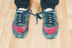 Shoes shoelaces tied to each other at aprill fool day b stock image