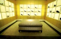 Shoes shop exposition. Luxury shoes shop exposition whit sofa stock photos