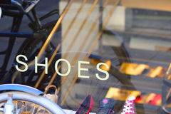 Shoes in shop window. Street reflecting Royalty Free Stock Image