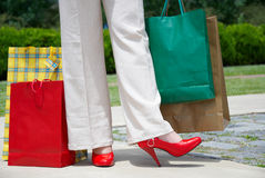 Shoes and shopping bags Stock Photo