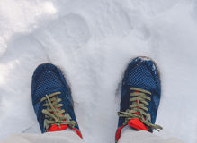 Shoes On Snow. Blue shoes sneaker on the snow in winter time Royalty Free Stock Photos