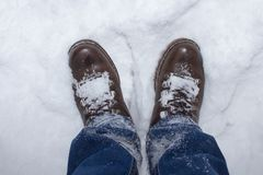 Shoes in the snow. Husband in the winter in shoes in laces in the snow Stock Photography