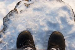 Shoes on a snow. Winter is comming concept Royalty Free Stock Images