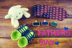 Shoes son with white teddy bear and necktie on rustic wooden. Background, father's day concept stock images