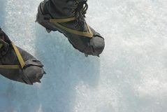Shoes with spikes on ice Royalty Free Stock Photo