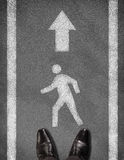 Shoes standing on asphalt road with two line and Stock Photos