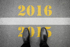 Shoes standing in front of new year 2016 line Royalty Free Stock Photography