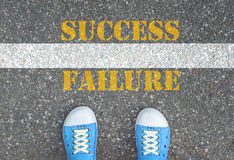 Shoes standing at the line between success and failure. Blue shoes standing at the line between success and failure Stock Photos