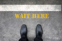 Shoes standing at wait here line Royalty Free Stock Photography
