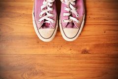 Shoes standing on wood background royalty free stock photography