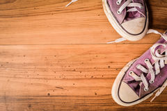 Shoes standing on wood background royalty free stock photos