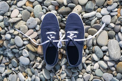 Shoes on the stones associated with the shoelaces Stock Photography